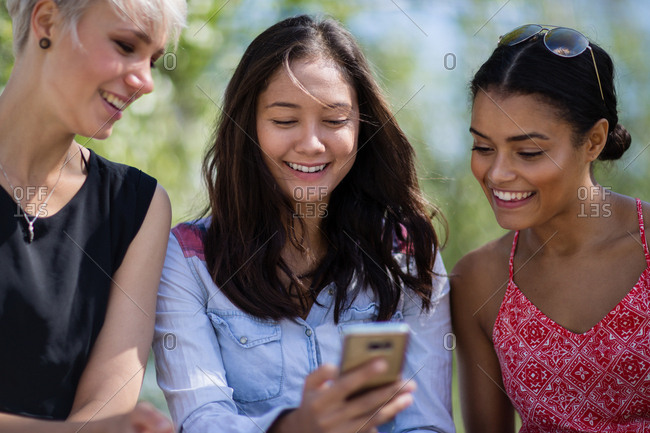 Female friends looking at smartphone