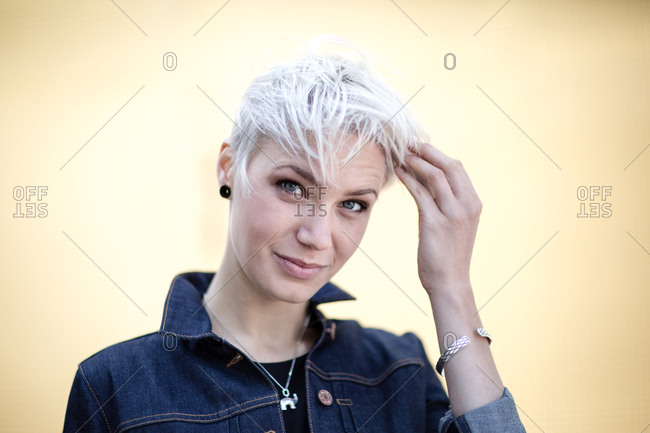 Young adult with hands in hair