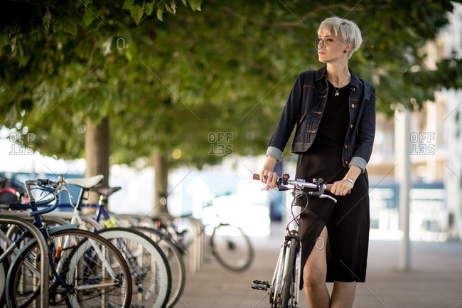 Young adult commuting on bike