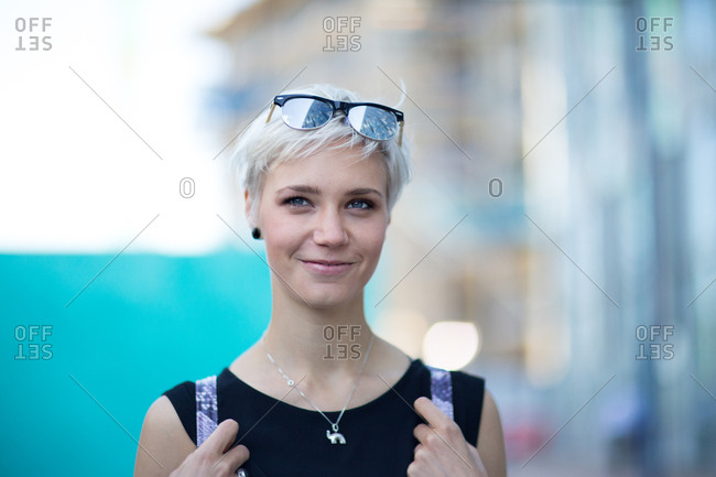 Young adult walking down street in a city