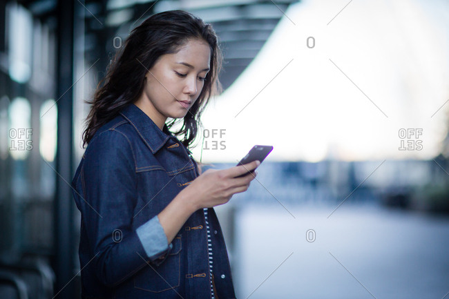 Young adult waiting on station platform
