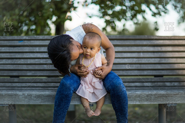 Mum kissing baby girl - Offset