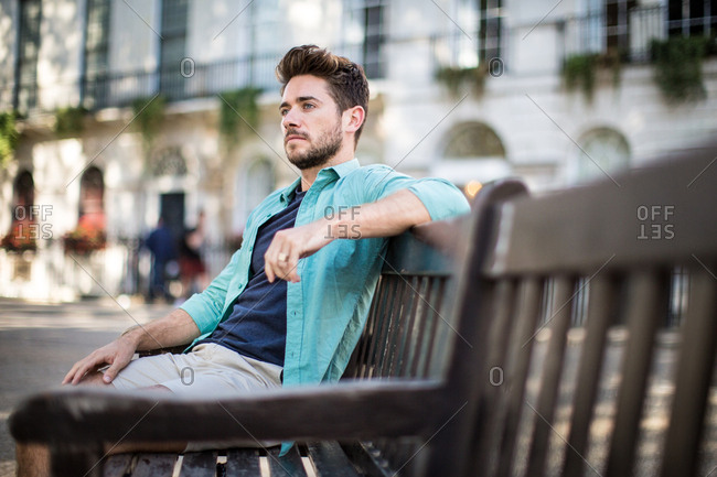 Tourist sitting on bench in London
