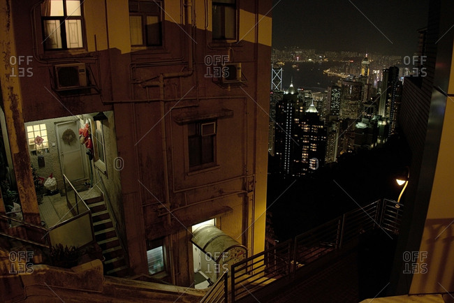 Hong Kong - December 25, 2014: Ordinary residential building in the outskirts of Hong Kong business district at night time, high angle view
