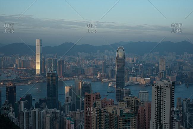 Hong Kong - December 23, 2014: Panoramic view of spectacular Hong Kong skyline and Victoria harbor
