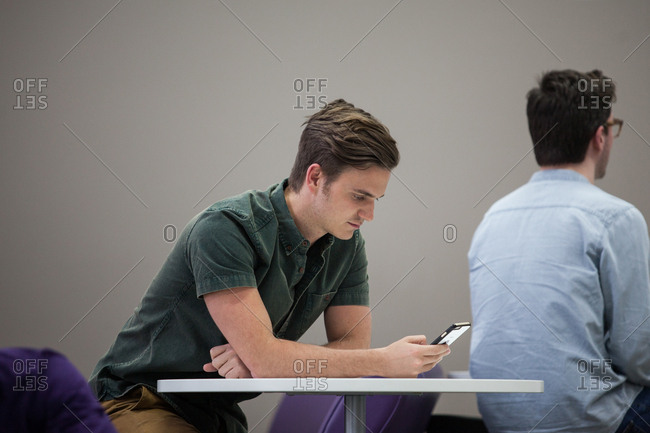 Man using smartphone in waiting area