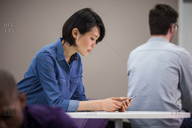 Woman using smartphone in waiting area