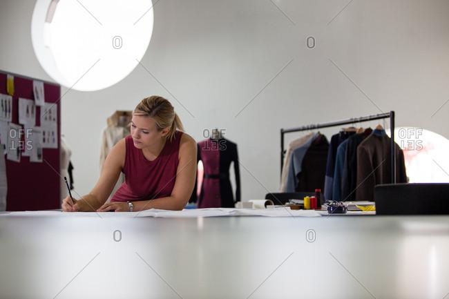 Fashion designer working on a pattern
