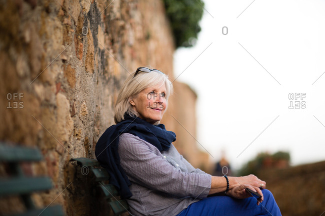 Senior woman relaxing on a bench