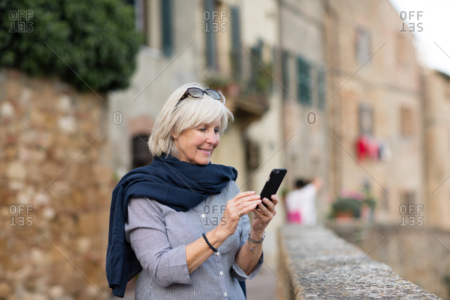 Senior woman on vacation using a smartphone