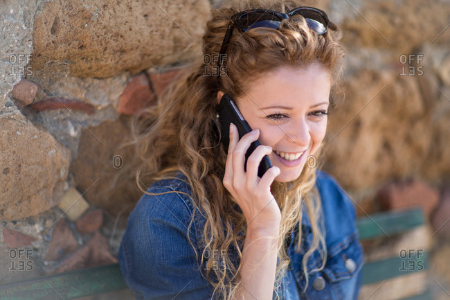 Young adult female talking on phone
