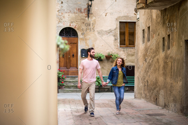 Young couple walking down street on vacation
