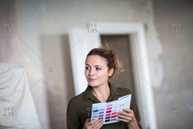 Young adult female choosing paint colors