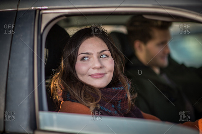 Young adult female driving car