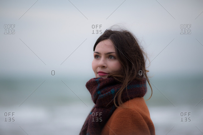 Young adult female on winter beach