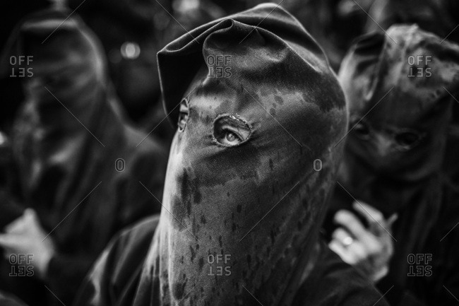 Portrait of hooded participant in Holy Week procession in Sicily