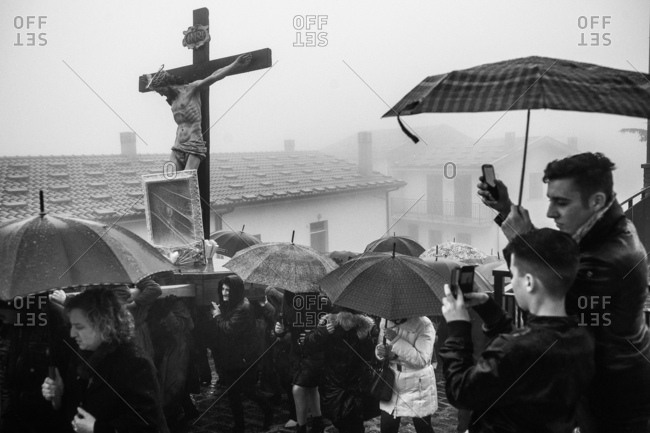 San Marco d'Alunzio, Italy - March 27, 2015: People using smartphones to take pictures of Holy Week procession in Sicily