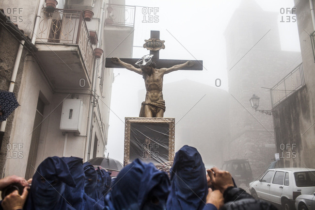 San Marco d'Alunzio, Italy - March 27, 2015: Crucifix and Madonna icon being carried by many people during Holy Week processing in Sicily