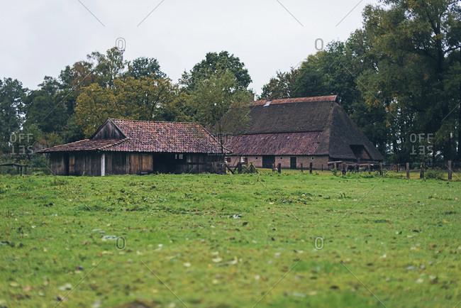 Antique farm in Dutch rural landscape.