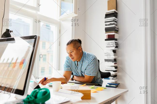 Editor using digital tablet in office