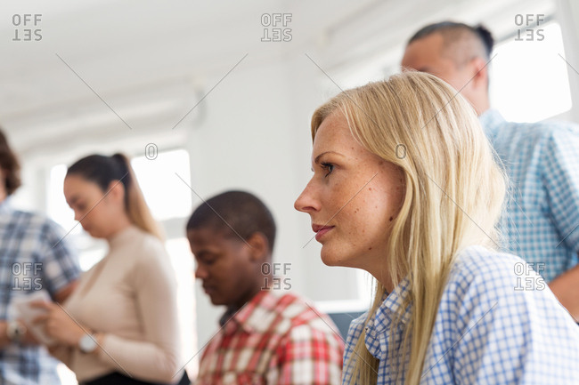 Coworkers listening during business meeting in office