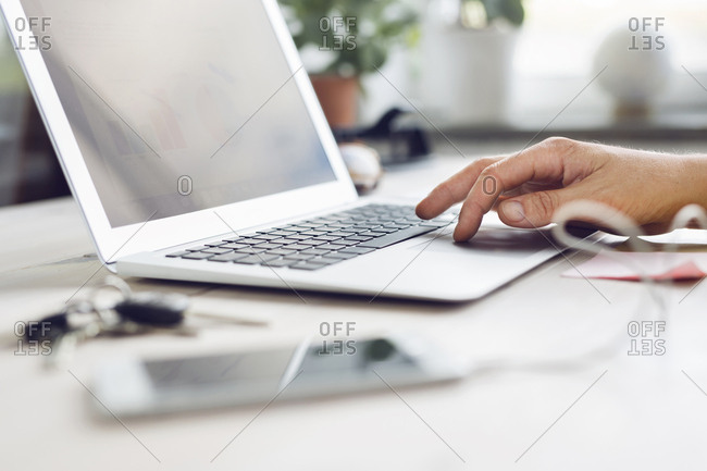 Person using laptop in office