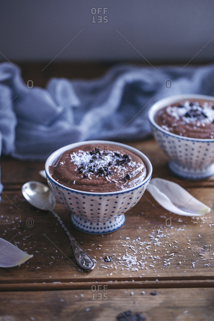 Chocolate coconut millet pudding served in little bowls