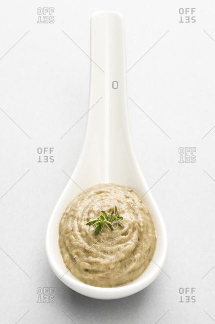 Chickpea hummus in a ceramic spoon