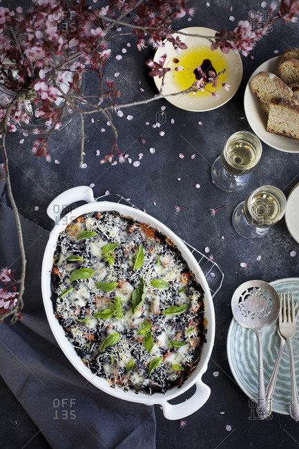 Black rice eggplant parmesan served with white wine and bread