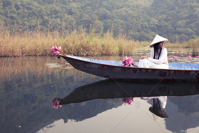 Vietnamese women sitting on boat, typical vietnamese landscape