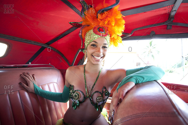 Tropicana dancer inside old American car
