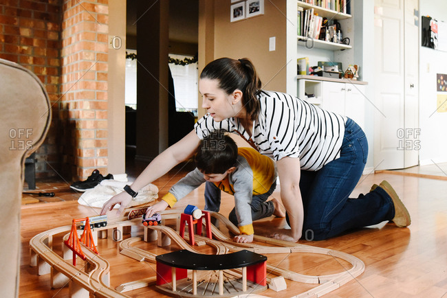Mother plays trains with son