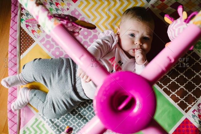 Baby girl on activity mat