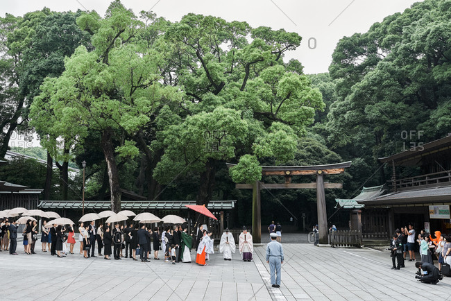 Tokyo, Japan - July 4, 2015: Traditional Japanese wedding ceremony taking place in the tourist-filled Meiji Jingu shrine in Yoyogi Park near Shibuya