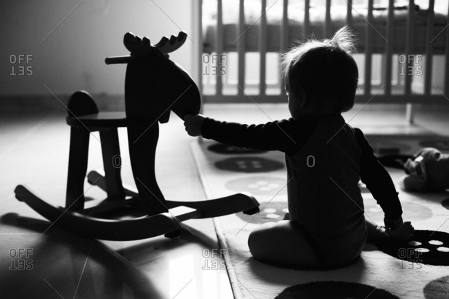 Silhouette of baby boy playing in his room