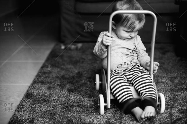 Baby boy sitting in wagon