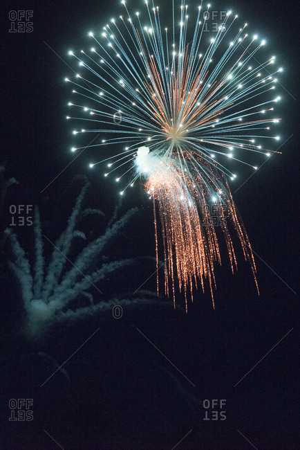 A fireworks display in sky