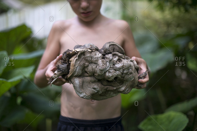 Boy with gnarled piece of wood