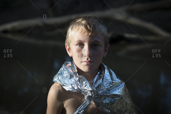 Boy using a thermal blanket as cape