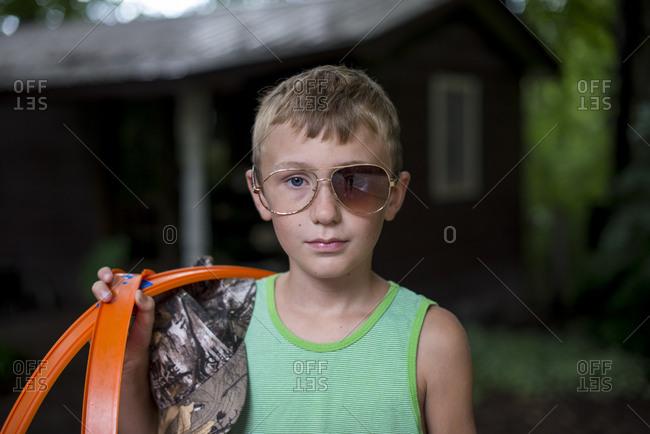 Boy wearing broken sunglasses