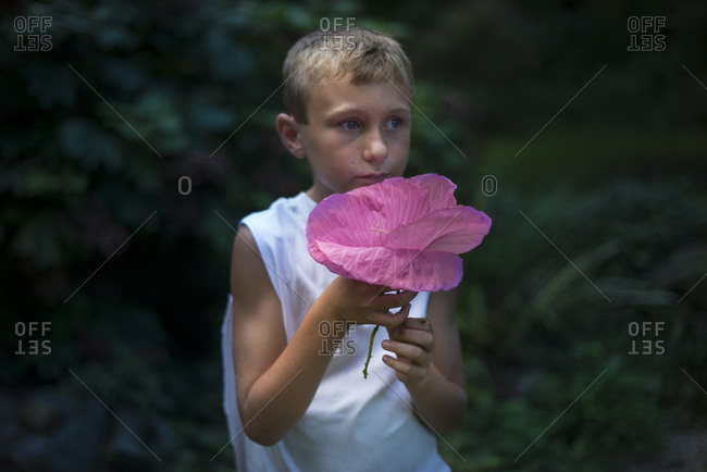 Boy with a hibiscus flower