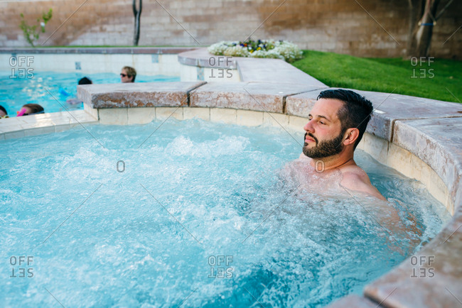 Man relaxing in outdoor spa