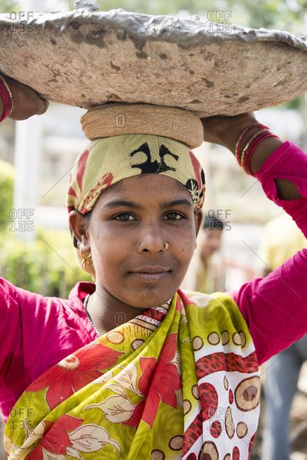 New Delhi, India - March 9, 2017: Portrait of manual laborer woman in Gurgaon, India