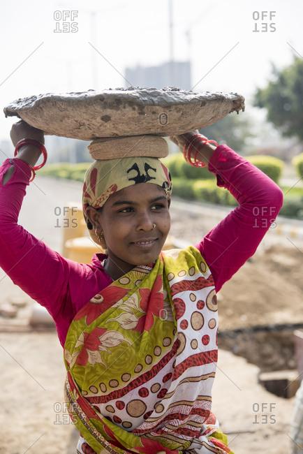New Delhi, India - March 9, 2017: Manual laborer woman in Gurgaon, India