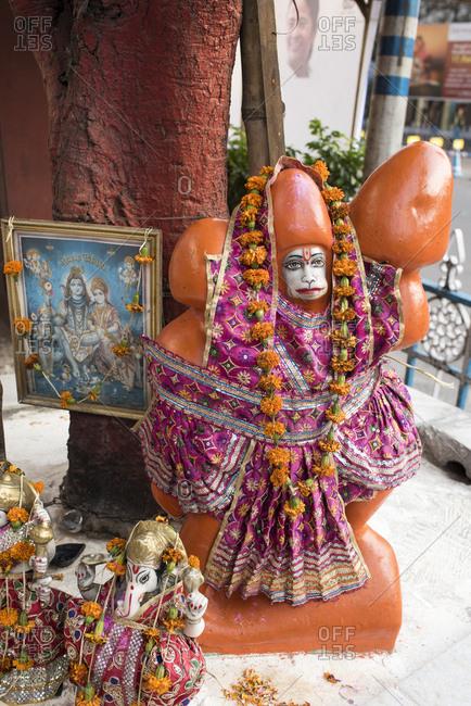 Street side Hindu shrine with Hanuman and other Hindu deities in Kolkata, India