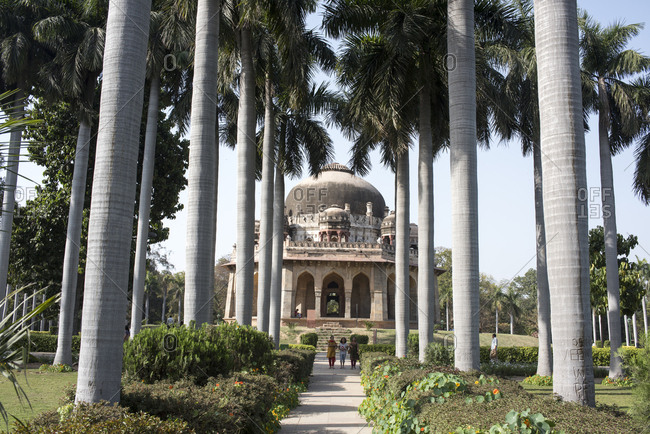 New Delhi, India - March 21, 2017: Tomb of Muhammed Shah and palm trees at Lodi Gardens, Delhi, India
