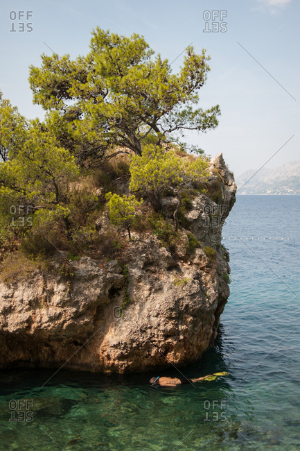 Man scuba diving on the coast of Makarska, Croatia