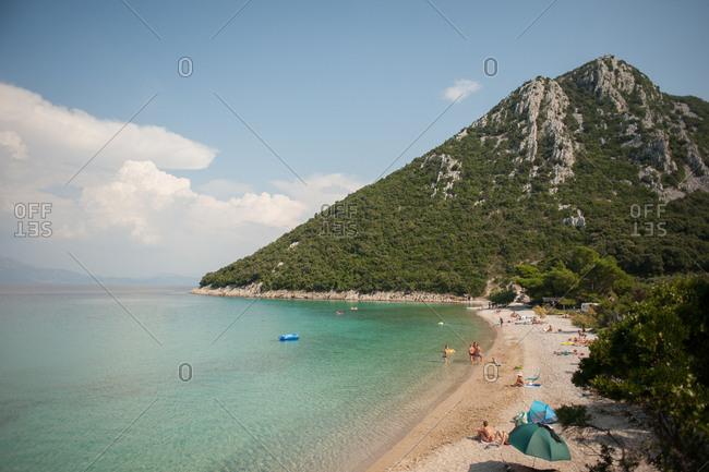 Peljesac Peninsula, Croatia - July 22, 2015: Beach and mountain on the coast of Peljesac Peninsula, Croatia