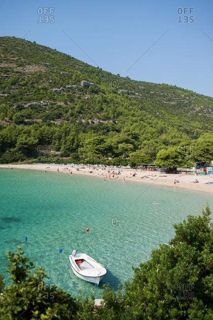 Peljesac Peninsula, Croatia - July 22, 2015: Boat moored near a beach on the Peljesac Peninsula, Croatia