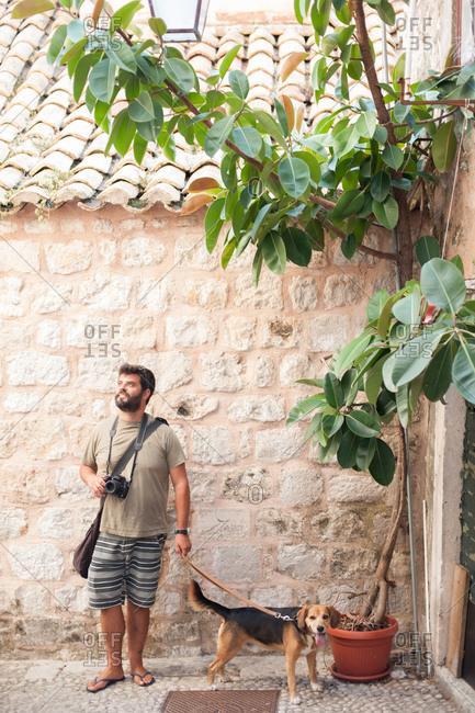 Dubrovnik, Croatia - July 22, 2015: Tourist walking his dog in Dubrovnik, Croatia